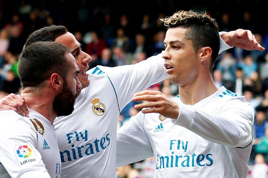 Ronaldo (right) celebrates with team mates after scoring the 2-1 lead.