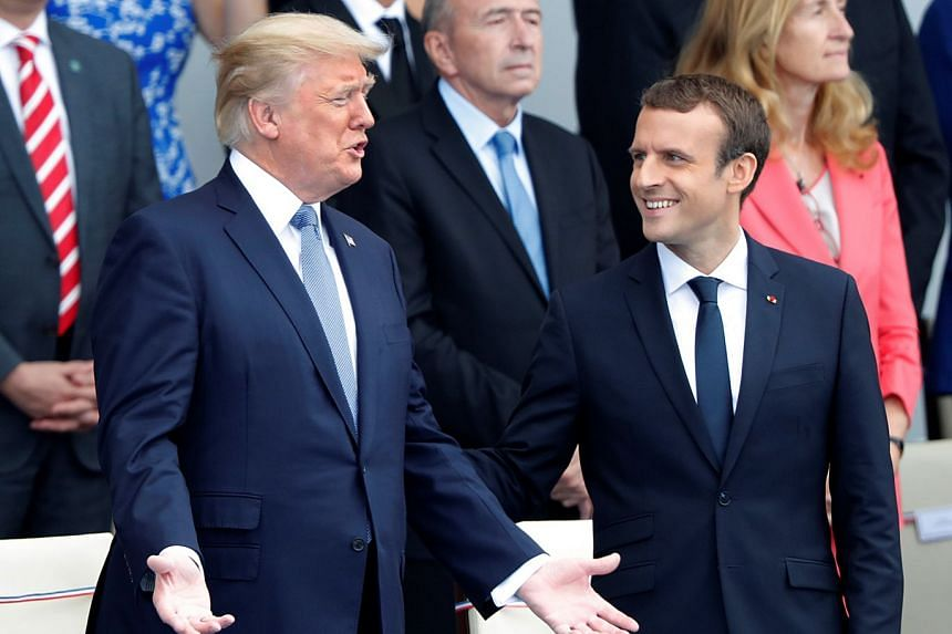 Trump attending the traditional Bastille Day military parade in Paris with Macron in July 2017..