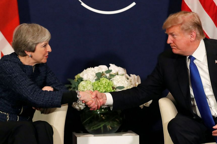 Trump shake hands with May during the World Economic Forum in Davos, Switzerland.