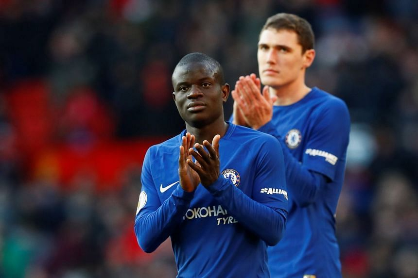 Chelsea's N'Golo Kante (left) applauding fans after a a match.