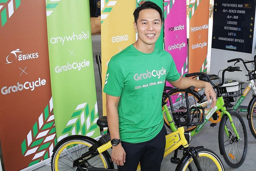 GrabVentures head Reuben Lai (above) says Grab will partner venue owners to roll out dedicated GrabCycle parking areas. On Sentosa (top), it aims to offer more than 10 parking areas.