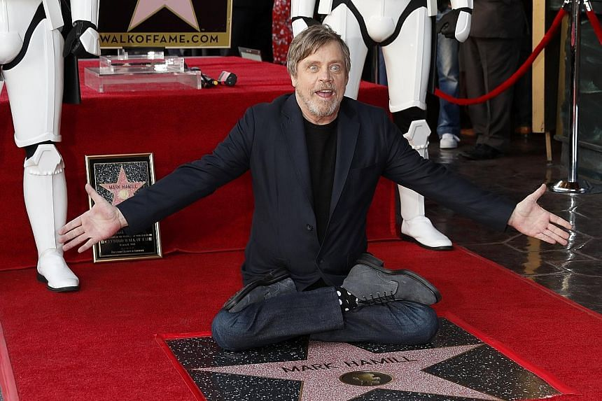 """Flanked by two Storm Troopers, Star Wars actor Mark Hamill (left) received a star on the Hollywood Walk of Fame on Thursday with the enthusiasm and humility that has endeared him to fans for four decades. Hamill, 66, told the cheering crowd: """"You are"""