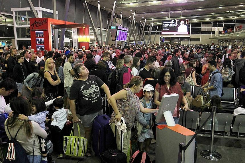 Uncomfortably long queues formed as passengers crowded the affected terminals at Sydney Airport. The glitch affected outbound flights from its international terminal and one of its two domestic terminals.
