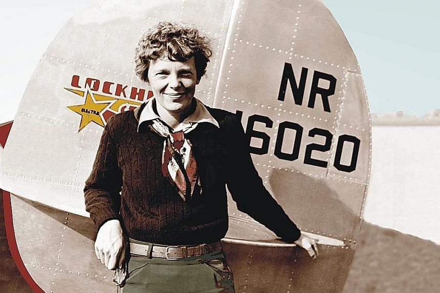 US aviator Amelia Earhart by the tail of her Lockheed 10 Electra on May 20, 1937, the day she began her attempt to become the first woman to fly around the world.