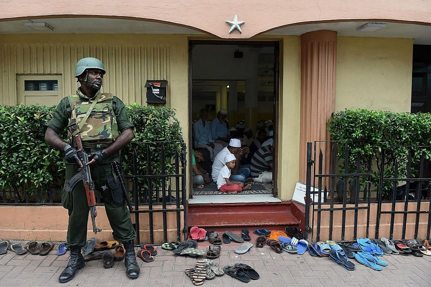 A Sri Lankan soldier guarding a mosque in Colombo yesterday. Police said tight security remained in place for the fifth consecutive day in Kandy and would remain across the district for the coming few days.
