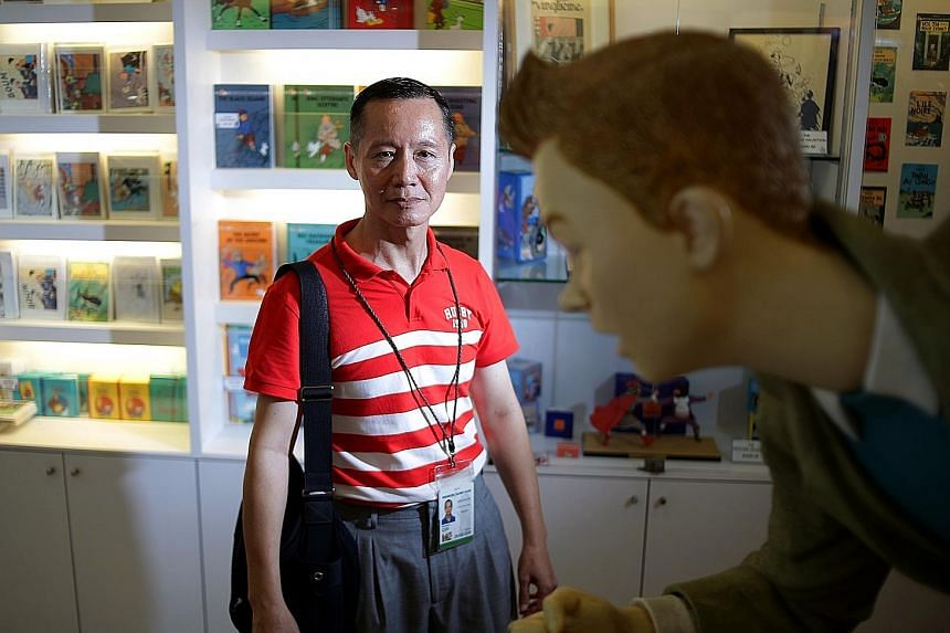 Part-time guide Peter Hong at The Tintin Shop, one of the stops on his niche tour of Singapore's toy scene.