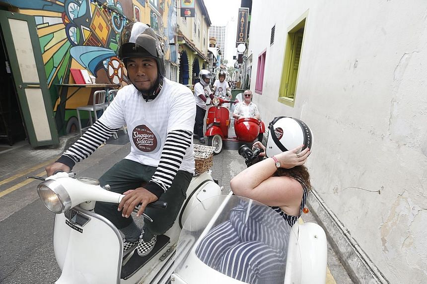 Scottish tourist Laura McAlpine and her husband setting off from Haji Lane for a unique tour in the sidecars of vintage Vespas. The tour, run by Singapore Sidecars, takes tourists off the beaten track around Singapore.