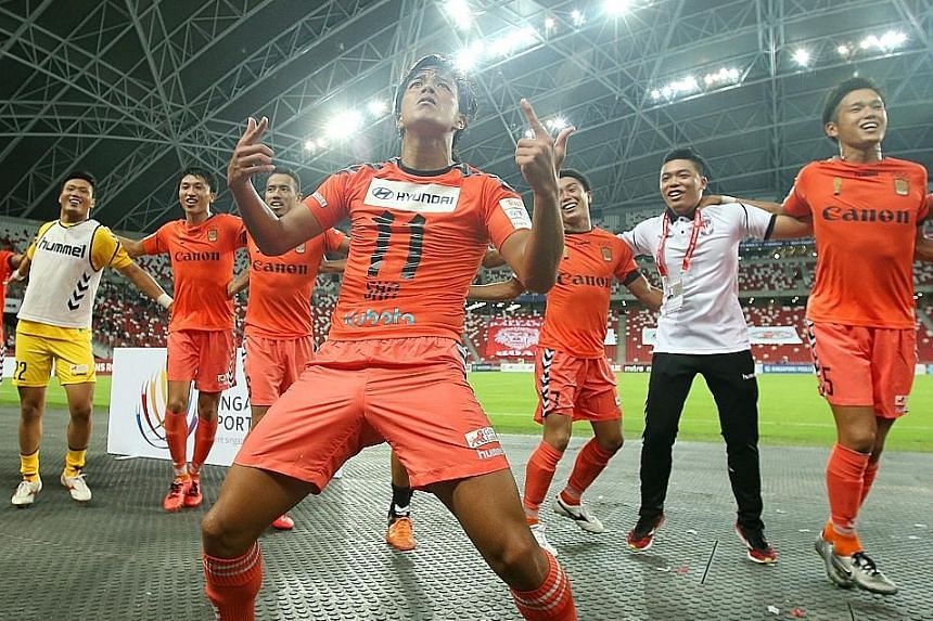 Albirex players celebrating their Community Shield title and three S-League points, after last year's 2-1 win over Tampines.