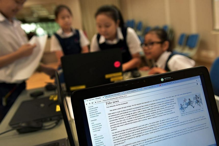 """Pupils from Teck Whye Primary School working on their project """"Maisipoo Tackles Fake News"""" last year. In January this year, Parliament voted to form a Select Committee to look into the challenges and implications posed by online falsehoods. The commi"""