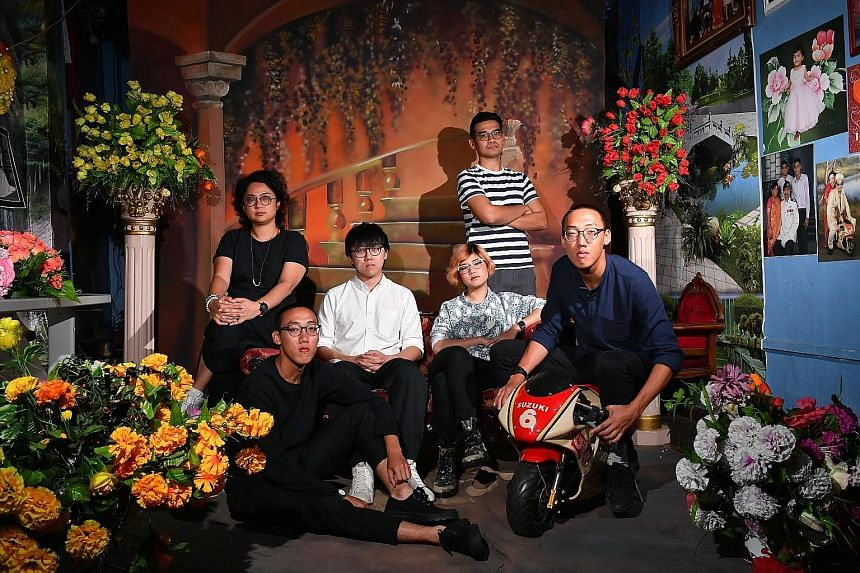 The people behind the urban guide, The City Ramble Stories (left), include (above from left) Ms Stella Gwee, Mr Lim Zeharn, Mr Ryan Len, Ms Ella Zheng, Mr Adib Jalal and Mr Lim Zeherng. They are at Sajeev Digital Studio, a stop featured in the guideb