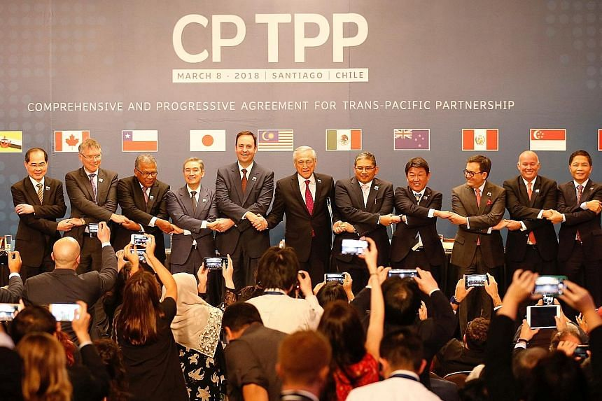 From left: Minister for Trade and Industry (Trade) Lim Hng Kiang; New Zealand's Trade Minister David Parker; Malaysia's secretary general of the Ministry of International Trade and Industry J. Jayasiri; Canadian Minister for International Trade Franc
