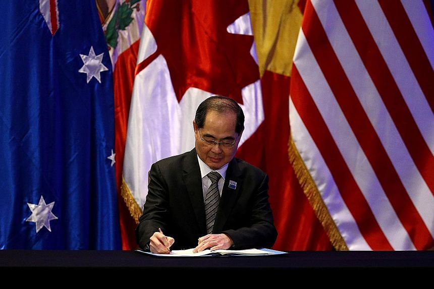 Singapore's Minister for Trade and Industry (Trade) Lim Hng Kiang signing the trade deal in Santiago on Thursday. Singapore is expected to be the second-biggest winner from the CPTPP after Malaysia, said Moody's, citing a report.