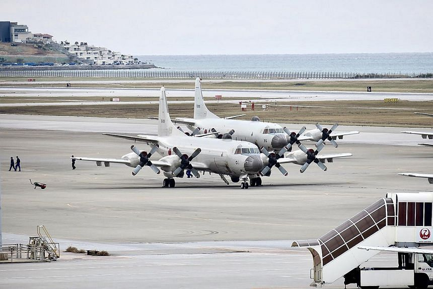 Ishigaki fisherman Yukihide Higa does not fish around the disputed Senkaku/Diaoyu islets due to safety concerns. (Above) Japan Air Self-Defence Force aircraft at Naha Air Base in Okinawa prefecture.