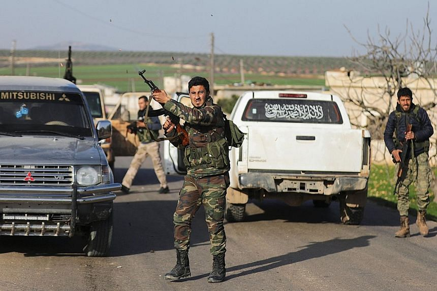 Turkish-backed Free Syrian Army fighters celebrating after advancing in the north of Afrin town on Thursday.