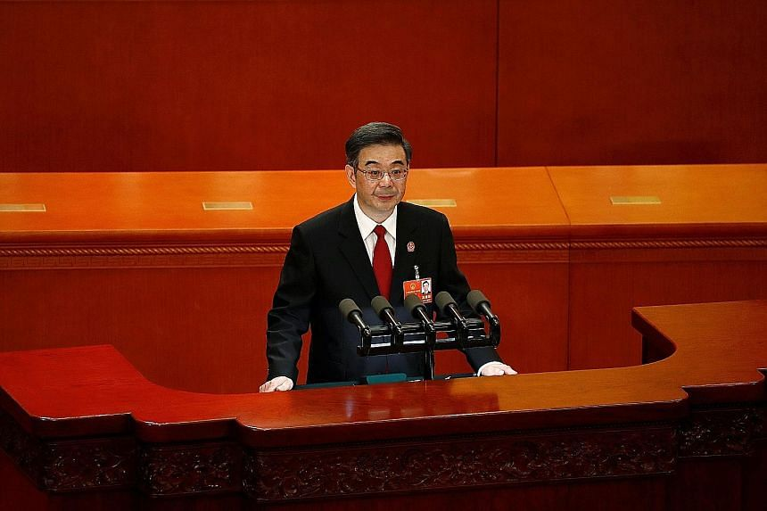 """Chief Justice Zhou Qiang of the Supreme People's Court said that among the measures the top court will take to support China's transition towards high-quality growth are """"strengthening legal protection of property rights and legally protecting honest"""