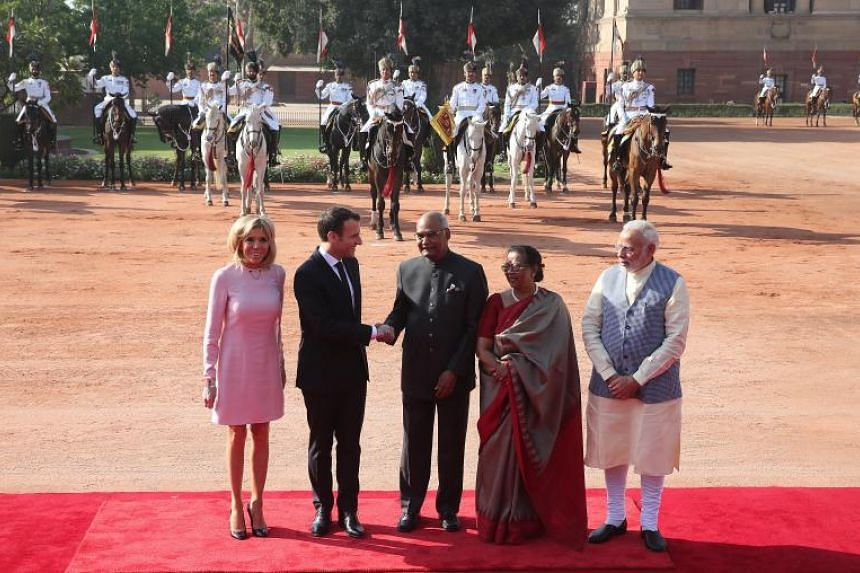 French President Emmanuel Macron (second from left) and his wife Brigitte Macron (left)  with Indian Prime Minister Narendra Modi (right) and Indian President Ram Nath Kovind (centre) and his wife Savita Kovind (second from right) in New Delhi, India