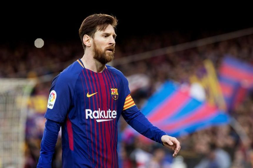 FC Barcelona's Lionel Messi reacts during a Spanish Primera Division soccer match between FC Barcelona and Atletico Madrid at Nou Camp stadium in Barcelona, north eastern Spain, on March 4, 2018.