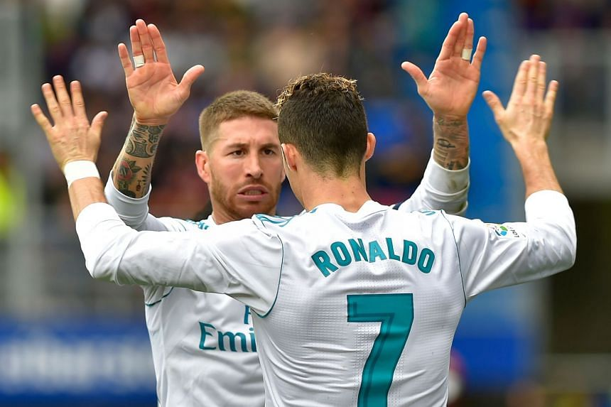 Ramos celebrates a goal during the match from Real Madrid's Portuguese forward Cristiano Ronaldo.