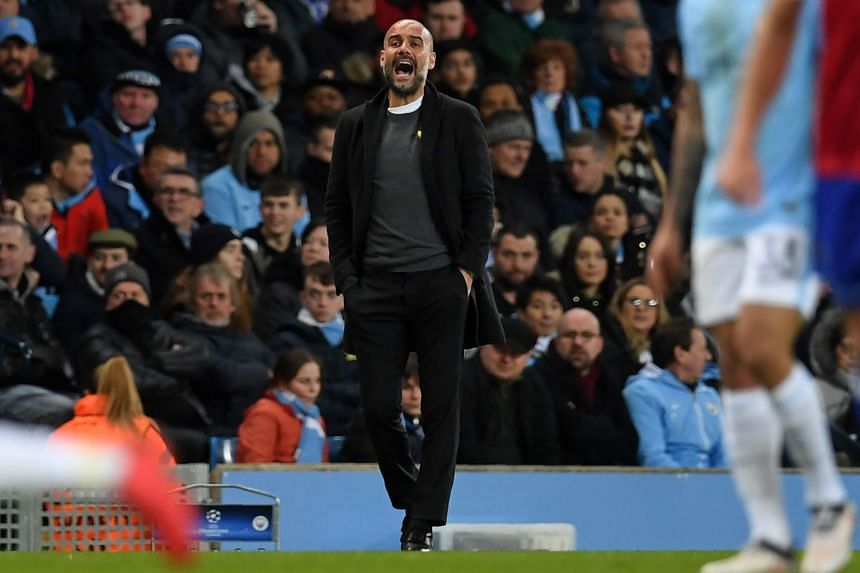 Guardiola gestures on the touchline during City's Champions League match against Basel.