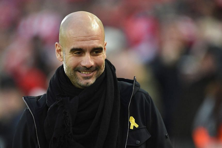 Guardiola wearing a ribbon in support of Catalan independence.