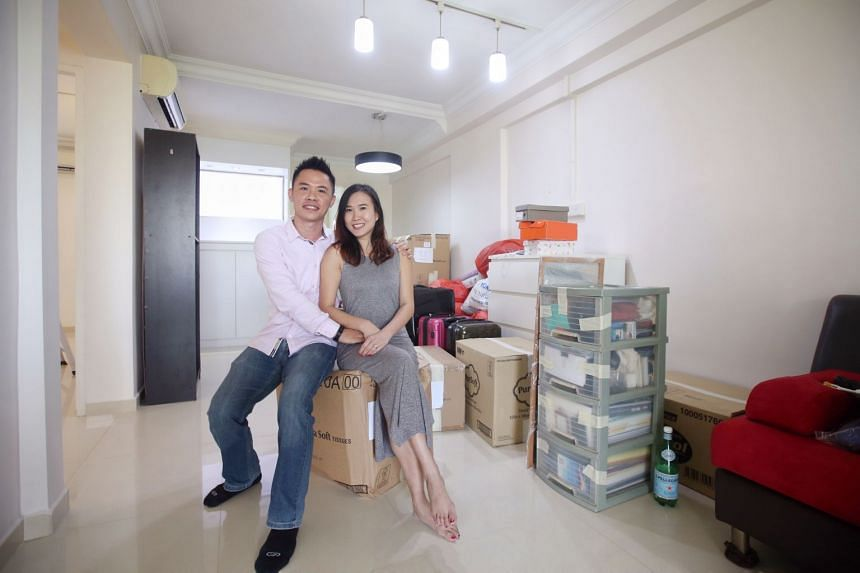Mr Chea Onn Long (left) and his wife Ms Mandy Chan in their new resale HDB flat in Hougang.