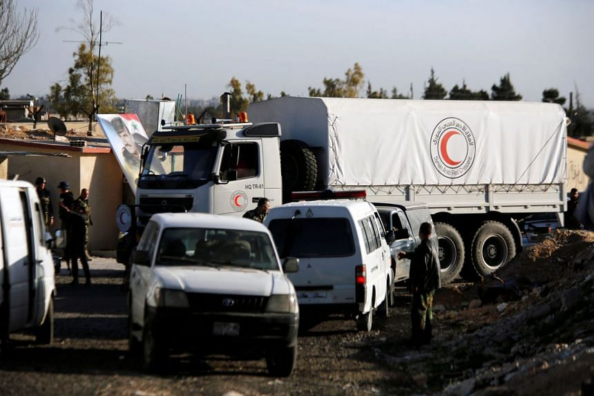 Aid covoy is seen after returning from eastern Ghouta in Damascus, Syria, on March 9, 2018.