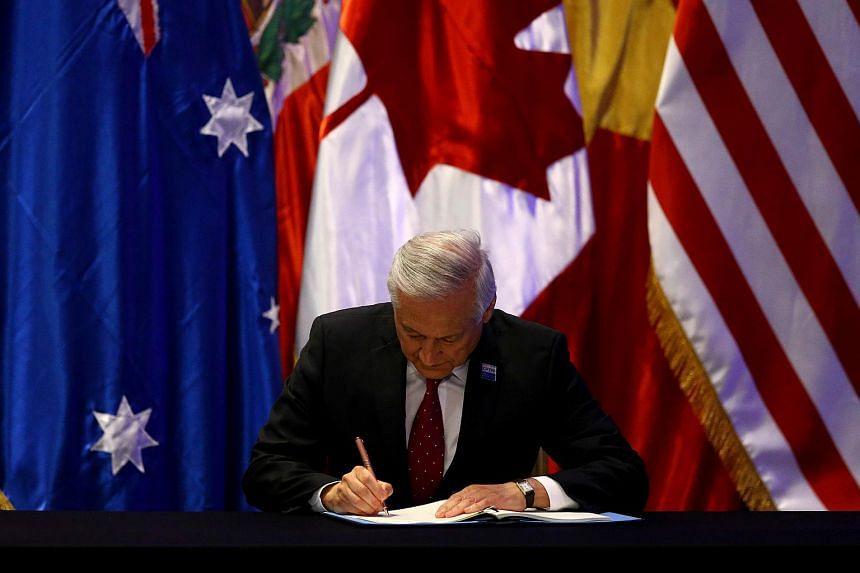 Chile's Foreign Minister Heraldo Munoz signing the Trans-Pacific Partnership trade deal, in Santiago, Chile, on March 8, 2018.