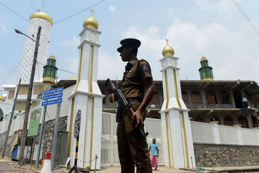 A policeman guards a mosque in Sri Lanka, Colombo, on March 9, 2018.