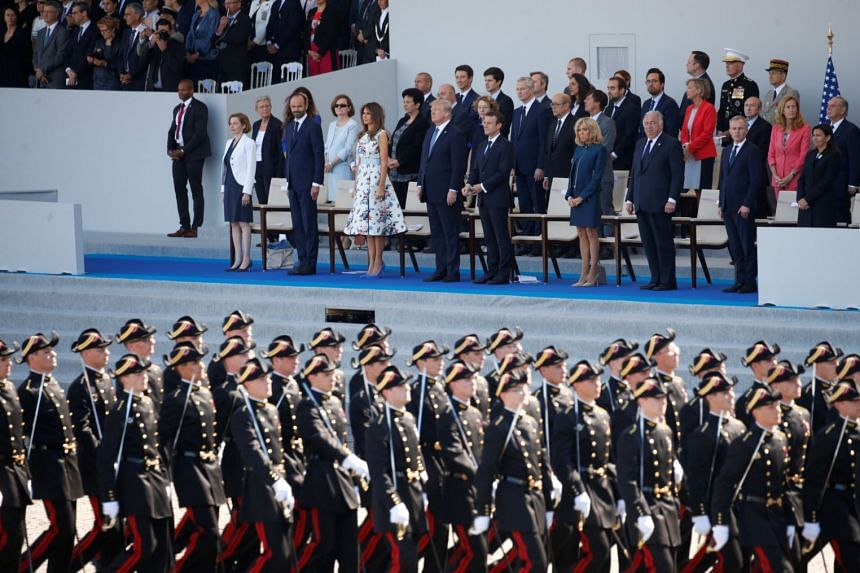 A file photo of US President Donald Trump and French President Emmanuel Macron at the Bastille Day military parade in Paris, France, on July 14, 2017.