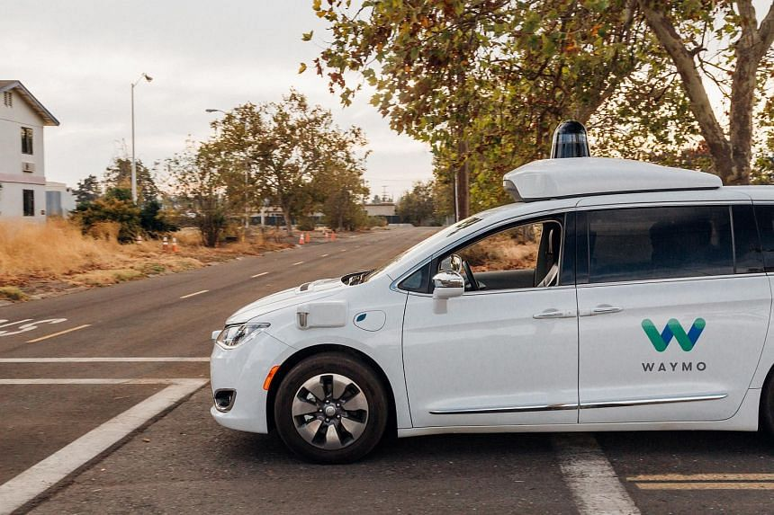 A Waymo self-driving van is tested in California.