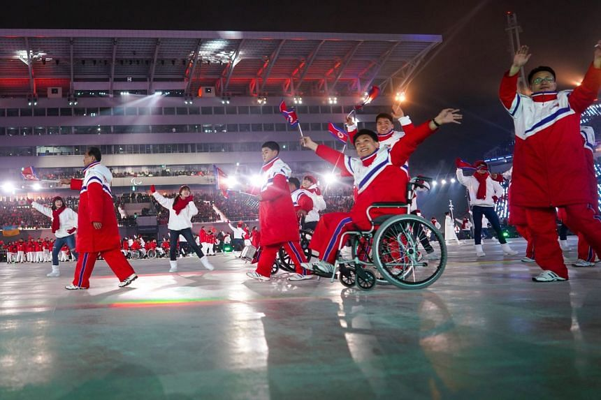 The North Korean team arrives at the opening ceremony of the 2018 Paralympic Games.