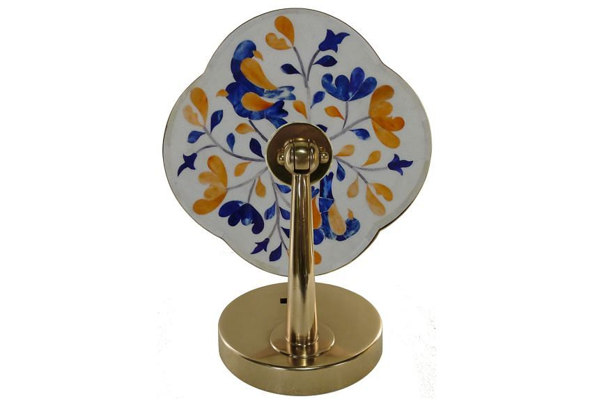 This desk mirror, part of home-grown furnishings brand Ipse Ipsa Ipsum's Peranakan Moderne collection, is handcrafted with coloured bone inlay pieces, together with a flower-shaped frame made of stainless steel and brass metal.