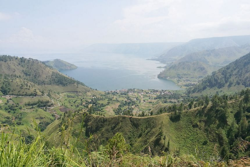 The newly renovated Silangit International Airport. The airport's upgrade is part of an ambitious effort by Indonesia to enhance smaller airports located close to tourist attractions and make them more accessible. Lake Toba as seen from one of numero