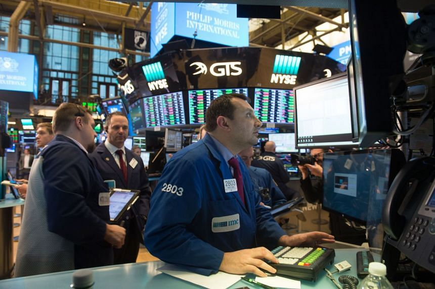 Traders working at the New York Stock Exchange on March 8, 2018.
