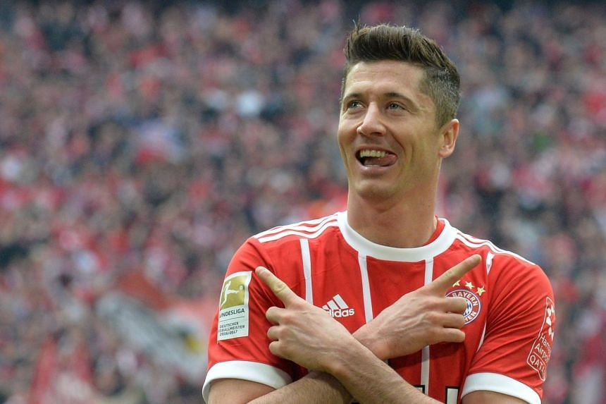 Lewandowski celebrates scoring the 3-0 goal.