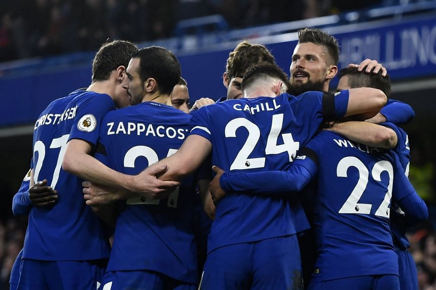 Chelsea players celebrate after Willian scores against Crystal Palace.
