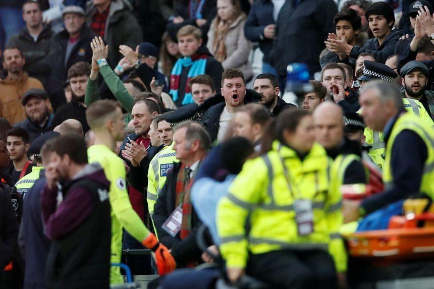 West Ham United fans react as Joe Hart walks off dejected after the match.