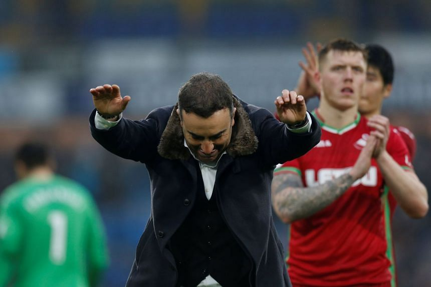 Swansea City manager Carlos Carvalhal salutes the fans after the match.