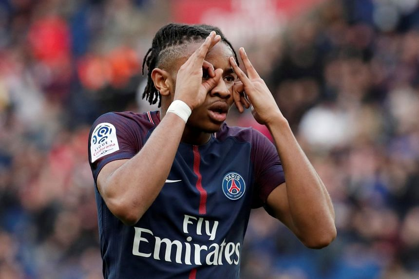 Paris Saint-Germain's Christopher Nkunku celebrates scoring their third goal.