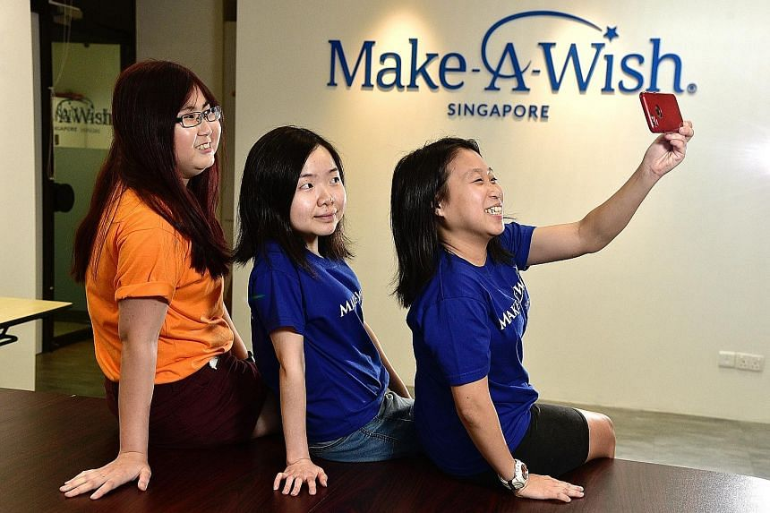 Former beneficiaries (from far left) Theresa Thang, Elina Toh and Sarah Tan see volunteering at Make-A-Wish Singapore as a way to bring joy to children.