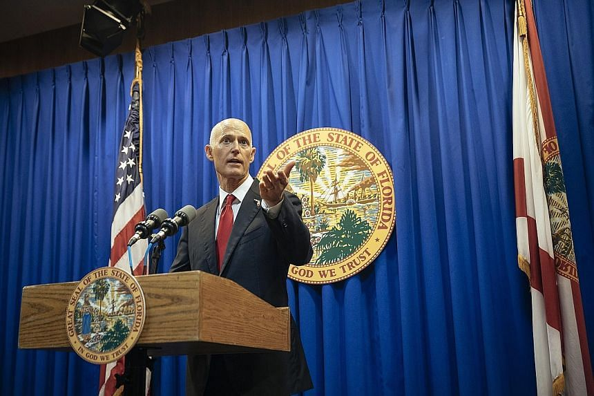 Republican Governor Rick Scott speaking in Tallahassee, Florida, last month. Mr Scott broke with the National Rifle Association on Friday to sign a law raising the minimum age and waiting period to purchase a gun in Florida.