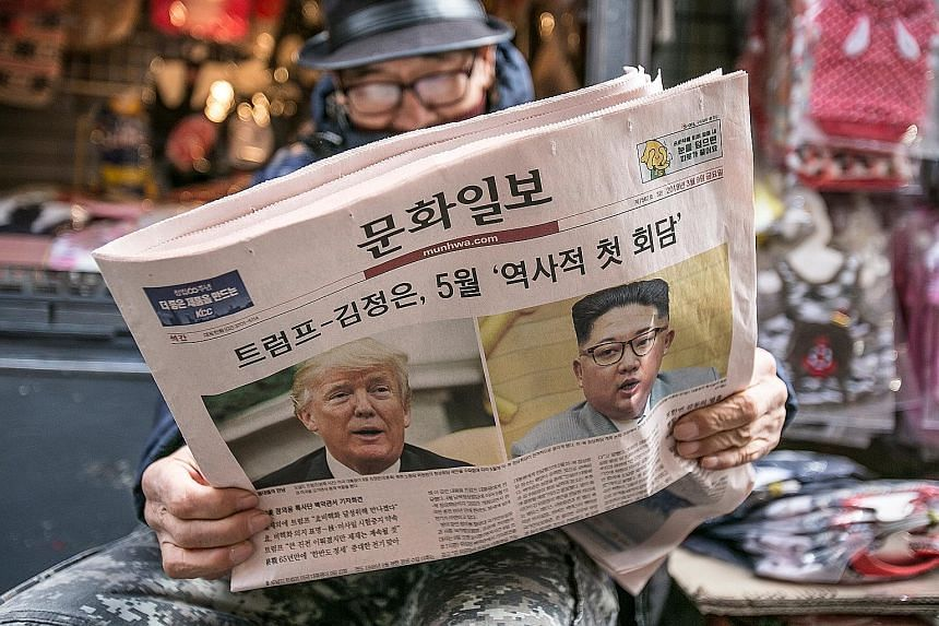 A South Korean newspaper with US President Donald Trump and North Korean leader Kim Jong Un on its front page. North Korea's diplomacy accelerated last week, punctuated by Mr Kim's meetings with South Korean envoys, and the announcement that he and M