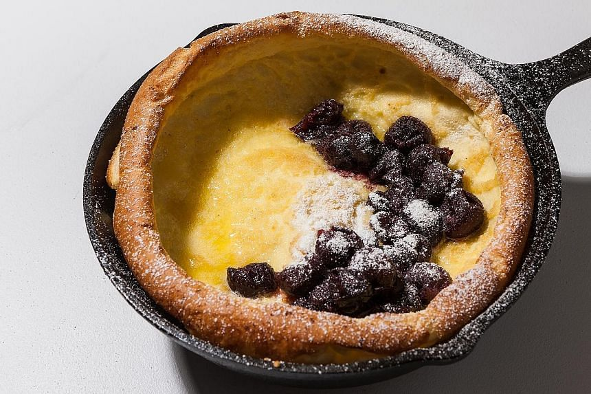 Dutch baby pancakes have an eggy crater in the centre and a puffy, slightly crisp edge.