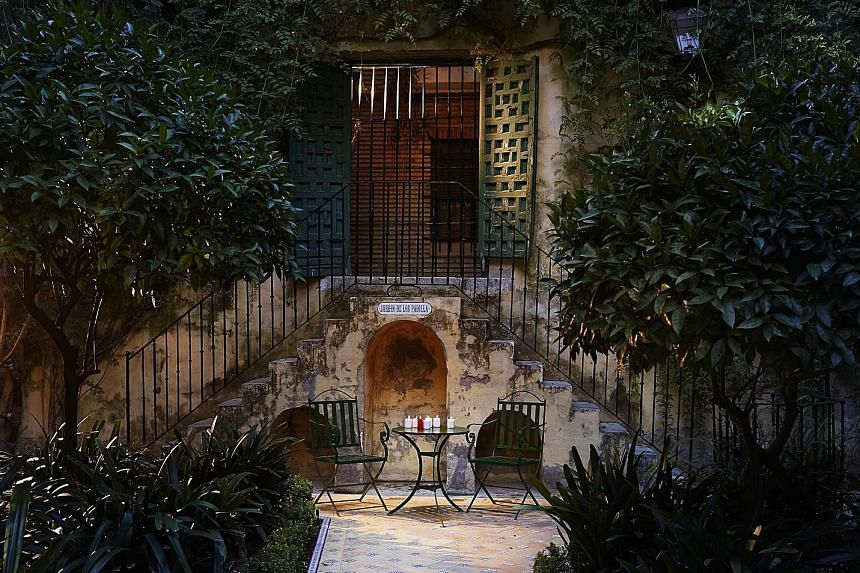 Hotel Las Casas de la Juderia (above) is a collection of elegant 15th-century Andalusian townhouses and flower-filled courtyards in the heart of Seville, Spain.