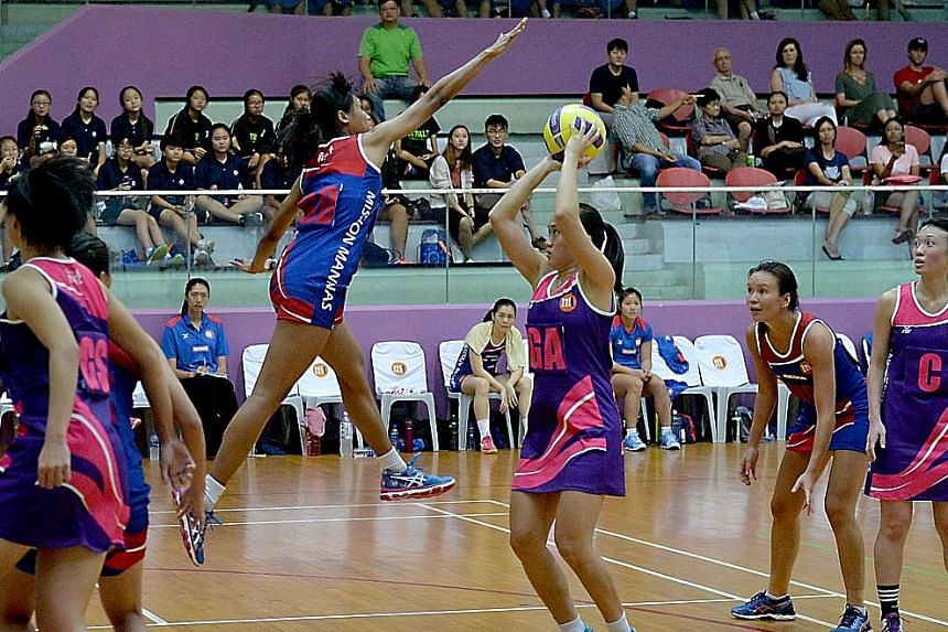 Mission Mannas goal defender Nurul Baizura attempting to block Sneaker Stingrays goal attacker Toh Kai Wei's shot. The Stingrays returned after a year out of the Netball Super League to edge out defending champions Mannas 58-57 in the season opener.