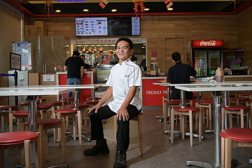 Mr Chan Hon Meng in his Hawker Chan outlet in 18 Tai Seng, after the peak-hour lunch period. Soon after his Chinatown hawker stall got a Michelin star, he partnered Hersing Culinary to expand his business.