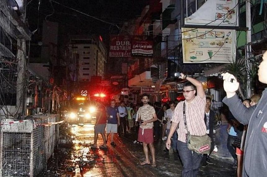 A number of barber and beauty shops and restaurants on the opposite side of the street were also damaged in the blaze.