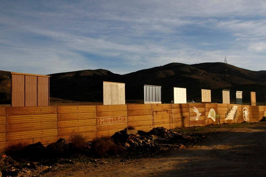 Prototypes for US President Donald Trump's border wall with Mexico are seen behind the current border fence in Tijuana, Mexico, on Jan 27, 2018.
