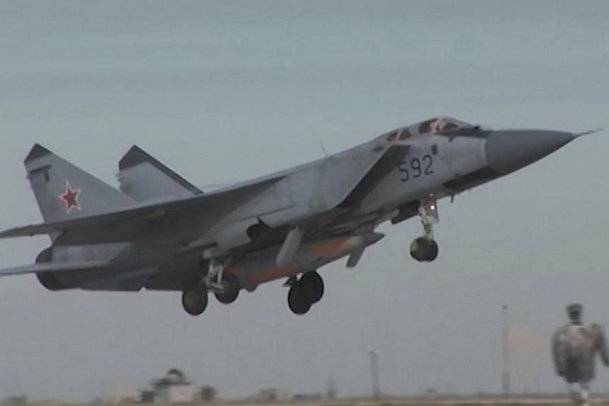 A Russian MiG-31 carrying the new Kinzhal hypersonic missile, as seen in a screen grab from an official video released by the Kremlin.