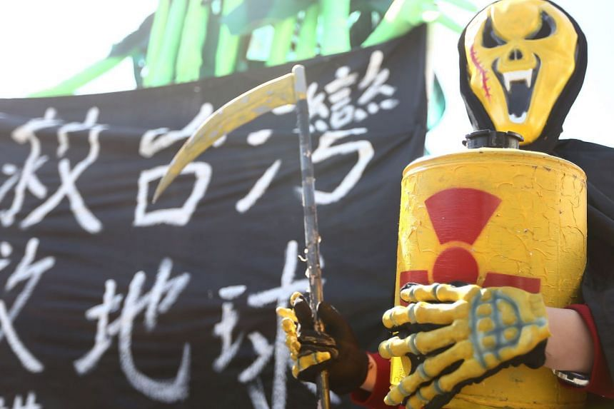 An activist taking part in an annual protest against the use of nuclear energy in front of the Presidential Office in Taipei on March 11, 2018.